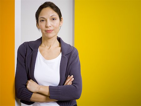 Portrait of a woman standing with her arms folded Stock Photo - Premium Royalty-Free, Code: 640-01351463