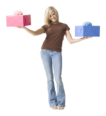 Portrait of a young woman holding gifts Stock Photo - Premium Royalty-Free, Code: 640-01351476