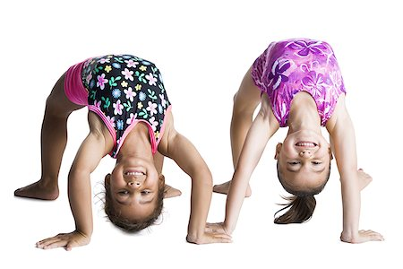 Young female gymnasts bending backwards Stock Photo - Premium Royalty-Free, Code: 640-01351488