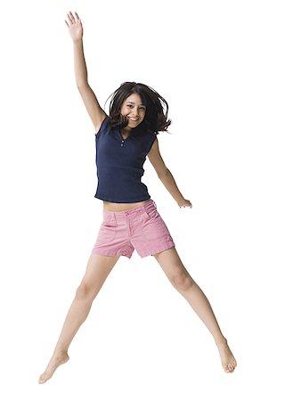 Teenage girl jumping Stock Photo - Premium Royalty-Free, Code: 640-01351539