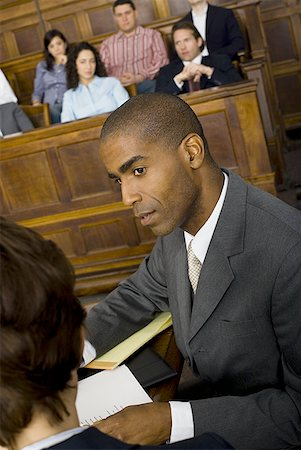 High angle view of a male lawyer in a courtroom during a trial Stock Photo - Premium Royalty-Free, Code: 640-01351616
