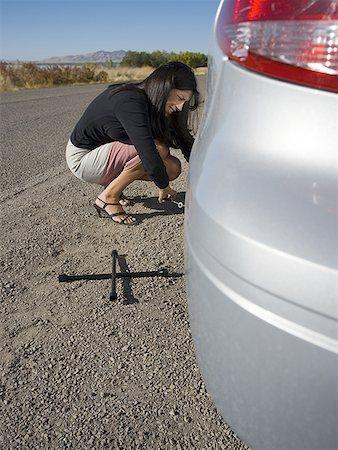 Profile of a woman repairing her car Stock Photo - Premium Royalty-Free, Code: 640-01351704