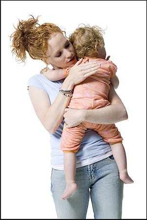 Close-up of a young woman hugging her daughter Stock Photo - Premium Royalty-Free, Code: 640-01351729
