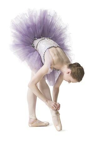 Ballerina tying her slipper Stock Photo - Premium Royalty-Free, Code: 640-01351921