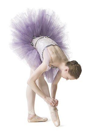 Ballerina tying her slipper Stock Photo - Premium Royalty-Free, Code: 640-01351921