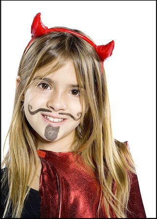 Close-up of a girl dressed as a devil Stock Photo - Premium Royalty-Free, Code: 640-01351985