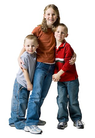 Portrait of a sister smiling with her two brothers Stock Photo - Premium Royalty-Free, Code: 640-01352122