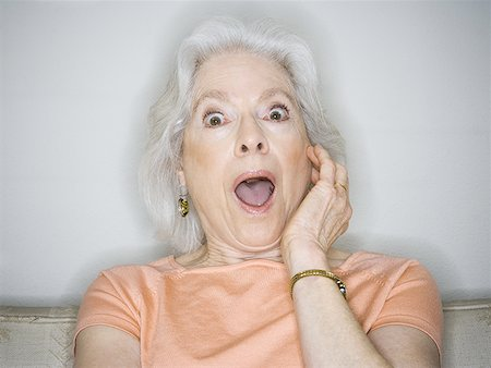 puff - Close-up of a senior woman with her mouth open Stock Photo - Premium Royalty-Free, Code: 640-01352236