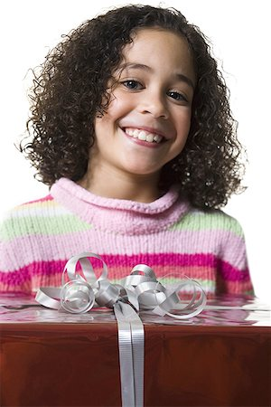 Close-up of a girl holding a gift box Stock Photo - Premium Royalty-Free, Code: 640-01352425
