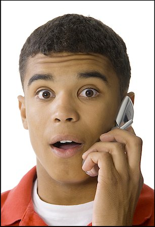 Portrait of a young man talking on a mobile phone Stock Photo - Premium Royalty-Free, Code: 640-01352430