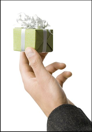 Close-up of a man's hand holding a gift Stock Photo - Premium Royalty-Free, Code: 640-01352451