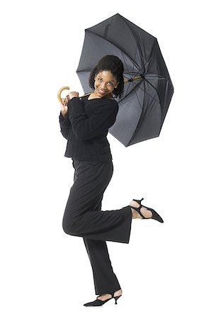 Portrait of a teenage girl holding an umbrella Stock Photo - Premium Royalty-Free, Code: 640-01352511