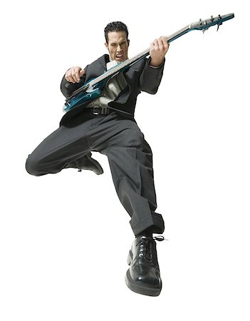 Low angle view of a businessman playing the guitar Stock Photo - Premium Royalty-Free, Code: 640-01352627
