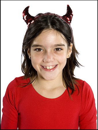 Portrait of a girl wearing devil's horns Stock Photo - Premium Royalty-Free, Code: 640-01352681