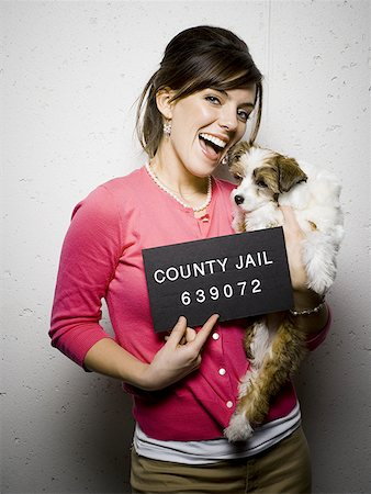 Mug shot of woman with dog Stock Photo - Premium Royalty-Free, Code: 640-01352841