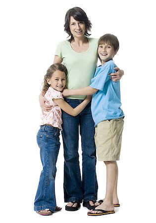 preteen thong - Portrait of a boy and a girl hugging their mother Stock Photo - Premium Royalty-Free, Code: 640-01353093