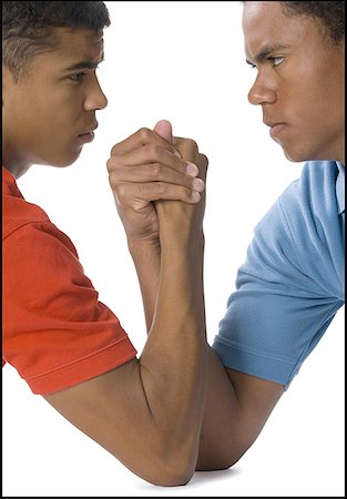 Close-up of two young men arm wrestling Stock Photo - Premium Royalty-Free, Code: 640-01353249