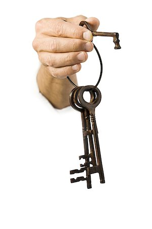 finger holding a key - Close-up of a key ring in a man's hand Stock Photo - Premium Royalty-Free, Code: 640-01353499