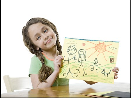 Portrait of a girl showing a drawing Stock Photo - Premium Royalty-Free, Code: 640-01353530