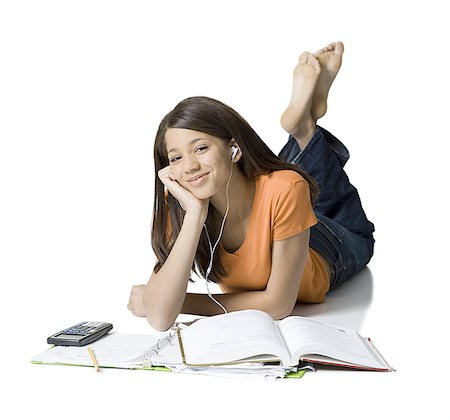Portrait of a girl listening to music and studying Stock Photo - Premium Royalty-Free, Code: 640-01353558