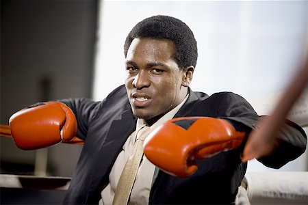 sweaty businessman - Portrait of a young man sitting in a boxing ring Stock Photo - Premium Royalty-Free, Code: 640-01353623