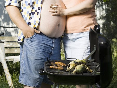 Overweight couple in a trailer park Stock Photo - Premium Royalty-Free, Code: 640-01353797