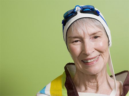 seniors and swim cap - Close-up of a senior woman wearing a swimming cap and swimming goggles Stock Photo - Premium Royalty-Free, Code: 640-01364153