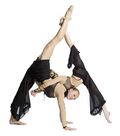 Female contortionist duo performing Stock Photo - Premium Royalty-Free, Code: 640-01364172