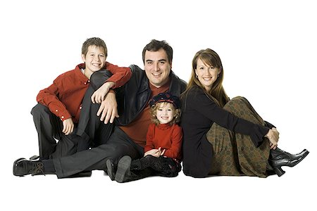 Portrait of a famliy sitting together Stock Photo - Premium Royalty-Free, Code: 640-01364376