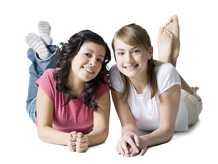 Portrait of two girls lying on the floor Stock Photo - Premium Royalty-Free, Code: 640-01364905