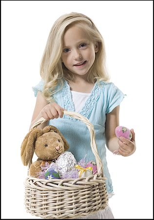 Girl holding Easter basket Stock Photo - Premium Royalty-Free, Code: 640-01364910