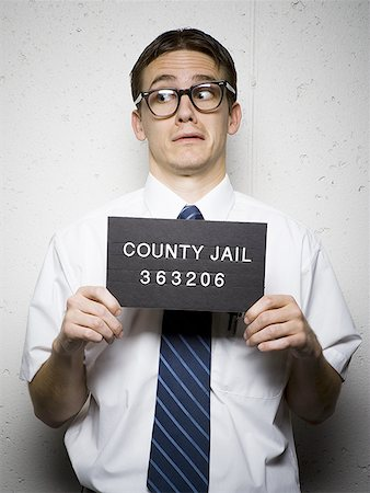 Mug shot of nerd with glasses Stock Photo - Premium Royalty-Free, Code: 640-01364966