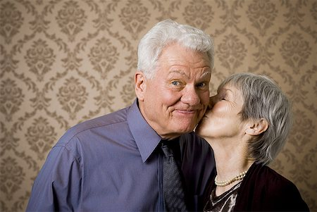 Close-up of an elderly woman kissing an elderly man Stock Photo - Premium Royalty-Free, Code: 640-01365157
