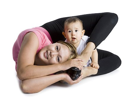 Contortionist mother with baby daughter Stock Photo - Premium Royalty-Free, Code: 640-01365387