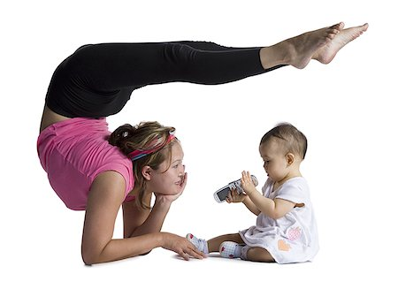 Contortionist mother with baby daughter Stock Photo - Premium Royalty-Free, Code: 640-01365467