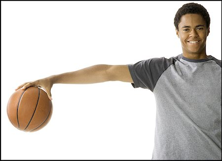 Portrait of a teenage boy holding a basketball Stock Photo - Premium Royalty-Free, Code: 640-01365672