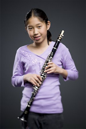 Portrait of a teenage girl holding a clarinet Stock Photo - Premium Royalty-Free, Code: 640-01365707