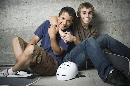 Portrait of two teenage boys smiling Stock Photo - Premium Royalty-Free, Code: 640-01365744