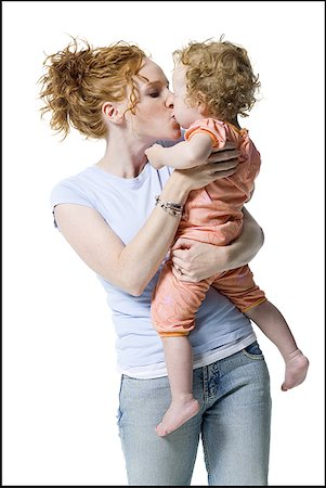 Close-up of a young woman kissing her daughter Stock Photo - Premium Royalty-Free, Code: 640-01365826