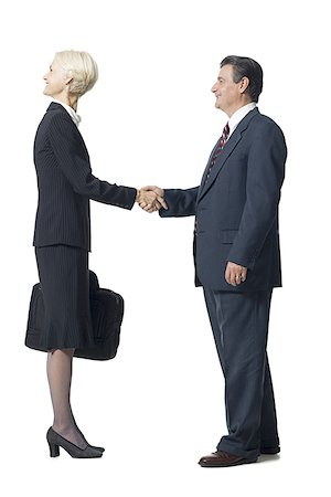female silhouette head and hand - Businesswoman with head backwards shaking hands with businessman Stock Photo - Premium Royalty-Free, Code: 640-01366162