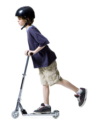 sports scooters - Profile of a boy riding on scooter Stock Photo - Premium Royalty-Free, Code: 640-01366303