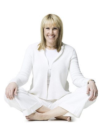female white background full body - Portrait of a mid adult woman sitting in the lotus position Stock Photo - Premium Royalty-Free, Code: 640-01366357