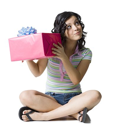 Close-up of a teenage girl holding a gift Stock Photo - Premium Royalty-Free, Code: 640-01366383
