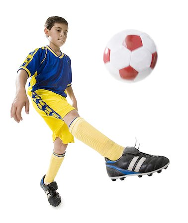 Low angle view of a boy playing soccer Stock Photo - Premium Royalty-Free, Code: 640-01360024