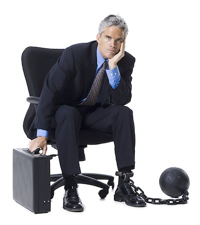 restrained - Businessman shackled to ball and chain Stock Photo - Premium Royalty-Free, Code: 640-01360418
