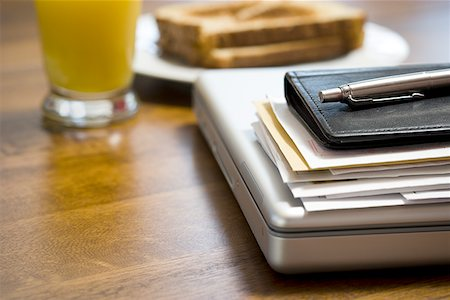 planner - Close-up of laptop daytimer and papers on desk Stock Photo - Premium Royalty-Free, Code: 640-01360528