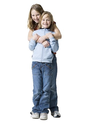 preteen kissing - Portrait of two sisters smiling Stock Photo - Premium Royalty-Free, Code: 640-01360556