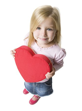 female silhouettes heart - Portrait of a girl holding a heart Stock Photo - Premium Royalty-Free, Code: 640-01360666