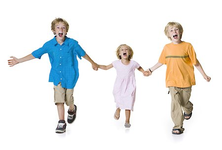preteen thong - Portrait of two brothers running with their sister Stock Photo - Premium Royalty-Free, Code: 640-01360877