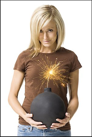 sparks with white background - Portrait of a young woman holding a bomb Stock Photo - Premium Royalty-Free, Code: 640-01360902